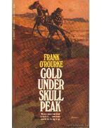 Gold under skull peak